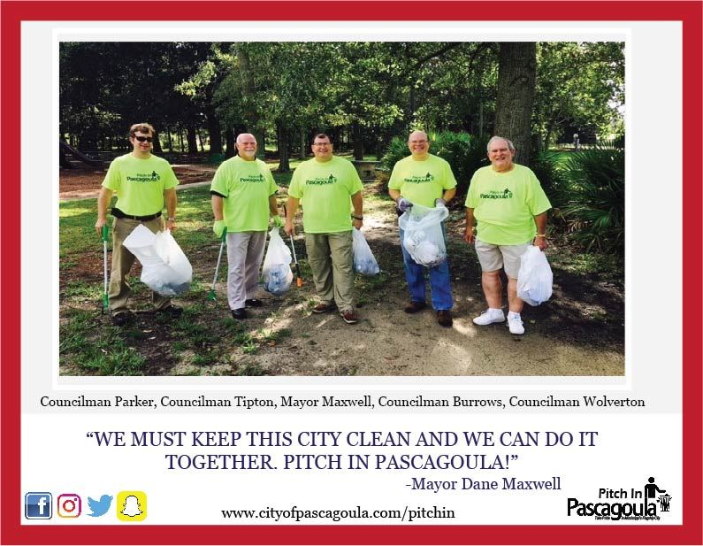 Mayor and Council in lime green shirts picking up trash