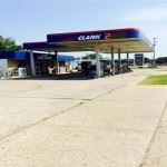 Clark gas station with vehicles at stations